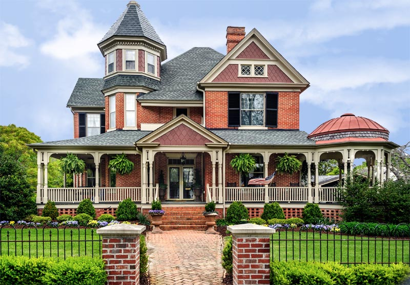 Victorian house with exterior shutter styles.