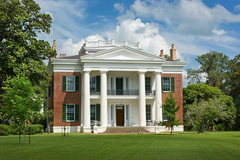 Exterior shutter styles shown on a historic plantation-plain house.