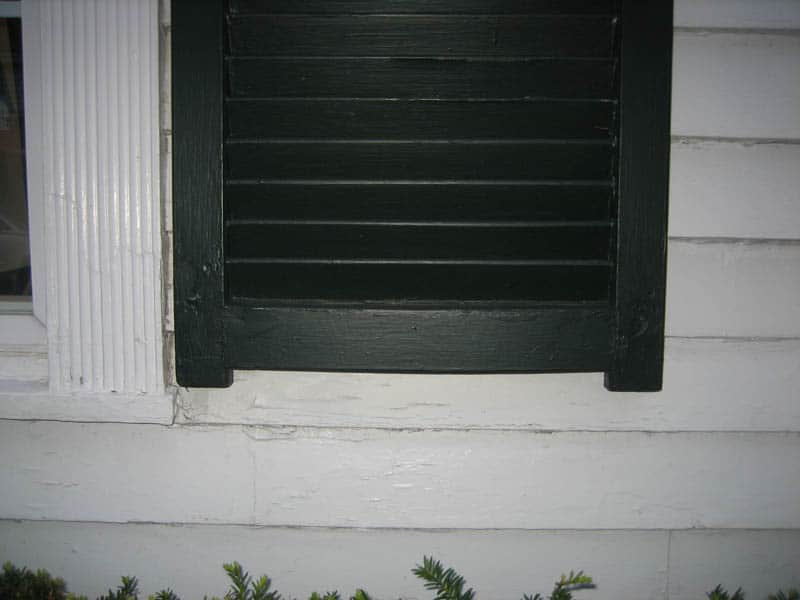 Wood exterior shutters with tails and horns.