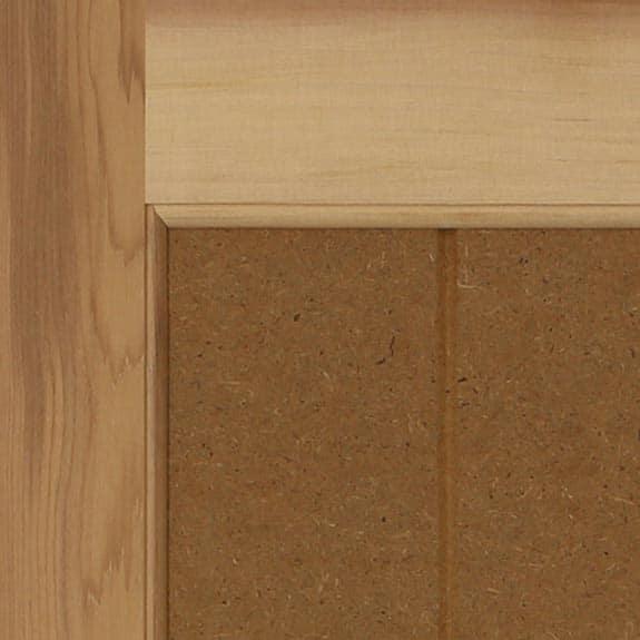 Western red cedar wood paneled exterior shutter close up.