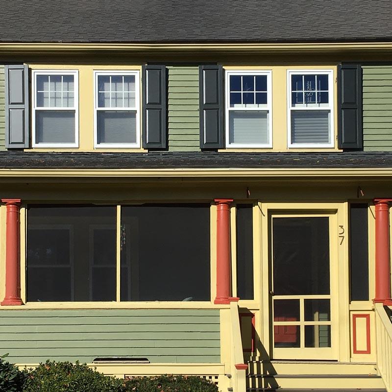 Raised panel composite shutters for outside windows on green house.