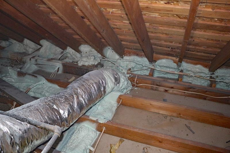 Remove old attic insulation to replace with R55.