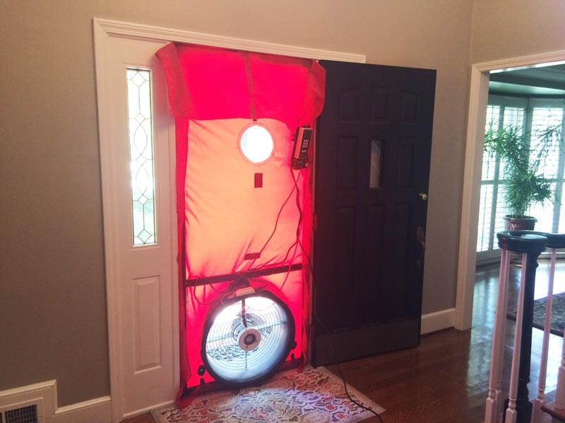 Blower door test to audit air leaks.