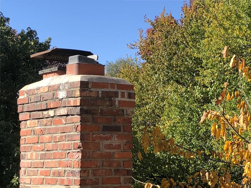 Chimney with damper that needs to be replaced.