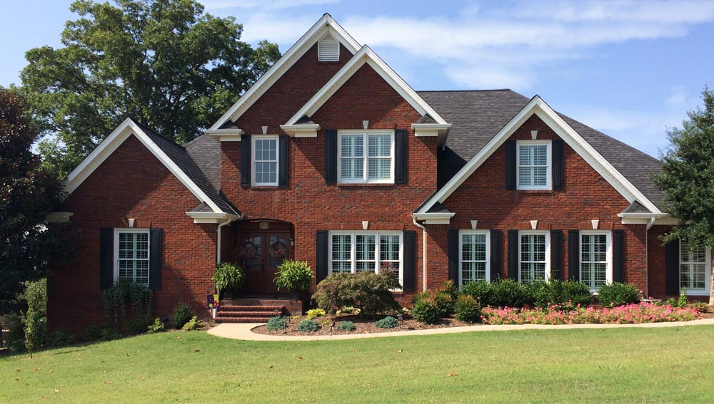 The best exterior vinyl shutters installed on brick.