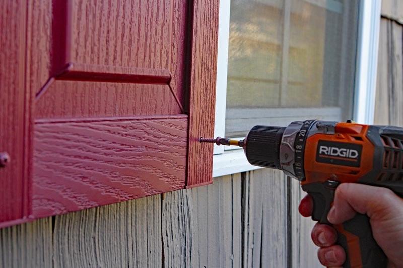 Install exterior vinyl shutters.