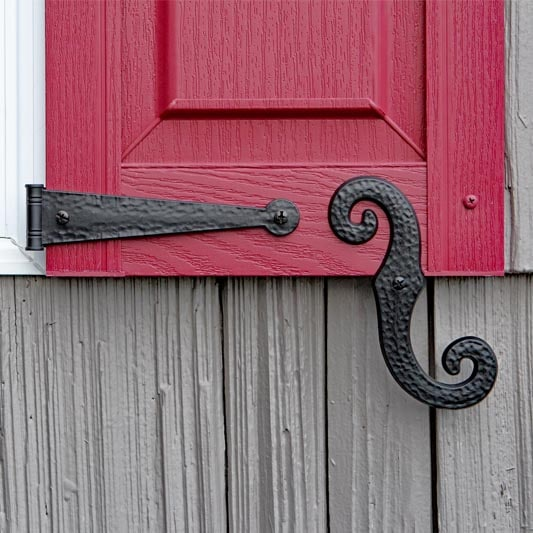Exterior vinyl faux hardware including hinge and dogs.