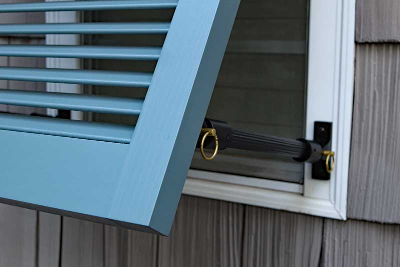 Exterior bahama shutter stay support hardware.