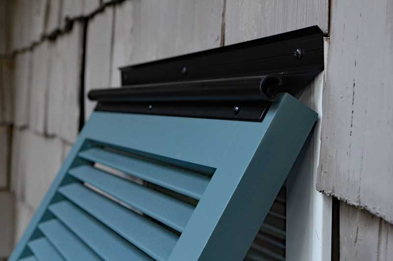 Outdoor Bahama shutter top mounted hinge.