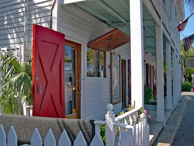 Red board and batten exterior colonial hurricane shutters.