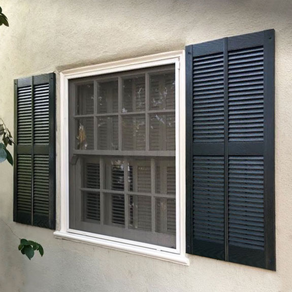 Double wide vinyl louvered shutters installed.