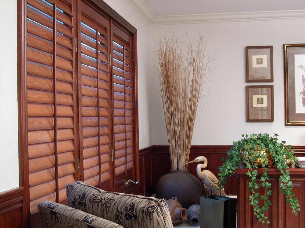 Wood plantation interior shutters that provides light control and insulation.
